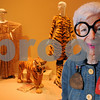 """Salem:<br /> Iris Apfel, an 86-year-old fashion icon, stands in front of part of the """"Ringmaster of Fashion"""" exhibit at Peabody Essex Museum. Her exhibit is featuring more than 80 dramatic ensembles from her personal collection.<br /> Photo by Ken Yuszkus/Salem News, Thursday October 8, 2009."""