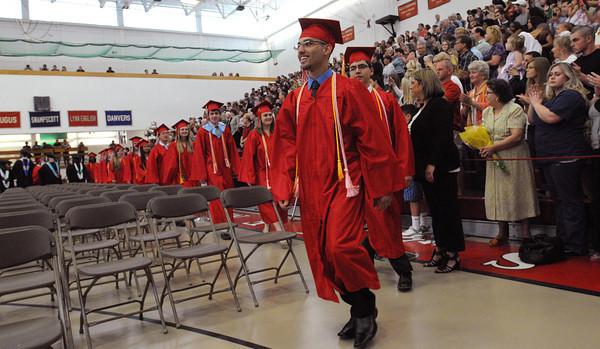 Salem:<br /> Valedictorian Jesus Morales leads the processional into the Salem High gymnasium for the graduation.<br /> Photo by Ken Yuszkus/Salem News, Friday, June1, 2012.