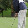 Salem:<br /> Gino Cresta, of Swampscott, putts on the 18th hole during the Northeastern Conference Golf Open at Kernwood Country Club. <br /> Photo by Ken Yuszkus/Salem News, Tuesday, October 18, 2011.