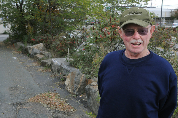 Salem:<br /> Richard Williams talks about the area where he would like to see a guardrail installed where the large stones are now.<br /> Photo by Ken Yuszkus/Salem News, Thursday,  October 14, 2010.