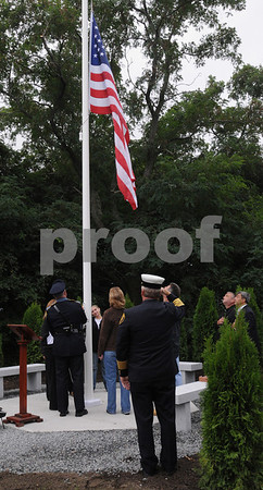 Peabody:<br /> The flag is placed at half mast toward the end of the dedication of the Peabody 9/11 Memorial Park. <br /> Photo by Ken Yuszkus/Salem News, Friday, September 11, 2009.