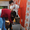 Wenham:<br /> Evie Hickey, left, helps Camille Garro, of Camille Garro Interiors, build her vignette for the upcoming North Shore Design Show at the Wenham Museum.<br /> Photo by Ken Yuszkus/Salem News, Tuesday, May 10, 2011.