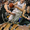 Boston:<br /> St. John's Prep's Pat Connaughton flies after tripping while going for the hoop during the St. John's Prep vs Mansfield in the boys state semifinal basketball game at the Boston Garden.<br /> Photo by Ken Yuszkus/Salem News, Tuesday March 15, 2011.