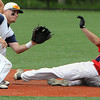 Danvers:<br /> St. John's Prep's Justin Peluso at second base as Central Catholic's Zach Bardwell slides in safely during a steal at the Central Catholic at St. John's Prep in Division 1 North first round state tournament. <br /> Photo by Ken Yuszkus/Salem News, Thursday, June 2, 2011.