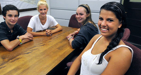 Danvers:<br /> From left, Patrick Huston, Lily Cuzner, Meghan Huston, and Stella Dalkouras talk about being CITs during the Camp Sunshine program for homeless kids this summer.<br /> Photo by Ken Yuszkus/The Salem News, Friday, August 24, 2012.