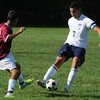 Peabody:<br /> Peabody's Shawn Bernado, right, kicks the ball down field during the Lynn English at Peabody boys soccer game.<br /> Photo by Ken Yuszkus/The Salem News, Tuesday, September 11, 2012.