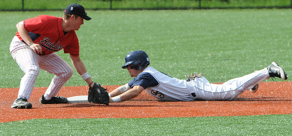 Danvers:<br /> St. John's Prep's Justin Peluso slides into second and is safe on a steal as Central Catholic's Colin Walsh tries for a tag during the Central Catholic at St. John's Prep in Division 1 North first round state tournament. <br /> Photo by Ken Yuszkus/Salem News, Thursday, June 2, 2011.