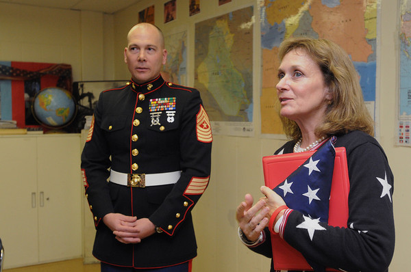 Peabody:<br /> Abbie Gore, right, history teacher at Peabody Veterans Memorial High School, speaks in front of her class after receiving a U.S. flag flown in Afghanistan from Sgt. major William Wells, left, of the U.S. Marines Thursday afternoon.<br /> Photo by Ken Yuszkus/Salem News, Thursday,  October 28, 2010.