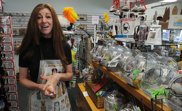 Salem:<br /> Nancy Ripa, owner of Living with Pets, at her business, describing the variety of items she sells.<br /> Photo by Ken Yuszkus/Salem News, Wednesday, June 9, 2010.