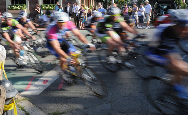 Salem:<br /> The racers of the 4/5 Category Mens speed through the corner from South Washington Square onto North Washington Square during the Witches Cup bicycle races around the common.<br /> Photo by Ken Yuszkus/Salem News, Wednesday, August 10, 2011.