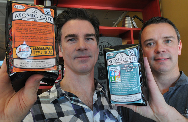 Beverly:<br /> Andrew Mahoney and his brother, John Mahoney, of the Atomic Cafe, hold up the bags of coffee which they sell to raise money for Bevelry Main Streets, and for Harborlight House.<br /> Photo by Ken Yuszkus/Salem News, Monday,  March 5, 2012.