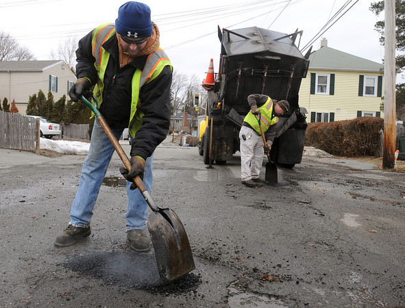 Beverly:<br /> Paul Mancaniello, left, and Renny Carroll, from the Beverly highway department, repair potholes on Hobart Avenue.<br /> Photo by Ken Yuszkus/Salem News, Wednesday, March 9, 2011.