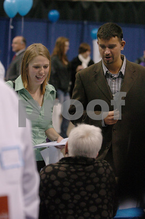 Salem:<br /> Stephanie Read and Peter Jervinis, both from Beverly and are seniors at Salem State College, talk to a company representative while roaming through the booths at the job fair at the college.<br /> Photo by Ken Yuszkus/Salem News, Monday, March 30, 2009.