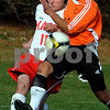 Topsfield:<br /> Curtis Staub of Masconomet, left and Nick Rocheville of Woburn, battle for the ball during the Masconomet vs Woburn boys soccer Division 1 North state tournament at Masconomet High School.<br /> Photo by Ken Yuszkus/Salem News, Monday November 9, 2009.