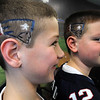 Beverly:<br /> Steven Brown, left, and his twin brother, Jack, just had the Patriots logo and the number 12 cut into their hair and colored at the Sportsmen Barber Shop in Beverly.<br /> Photo by Ken Yuszkus/Salem News, Tuesday, February 1, 2012.
