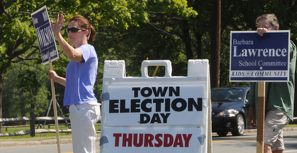 Hamilton:<br /> Cindy Shaw and Bob Bannon wave as they stand outside with signs in front of the  Winthrop Elementary School during the town election.<br /> Photo by Ken Yuszkus/Salem News, Thursday, May 24, 2012.