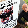 Swampscott:<br /> Mark Wolper is in need of a kidney, and decided to advertise with posters around Swampscott.<br /> Photo by Ken Yuszkus/Salem News, Wednesday, June 2, 2010.
