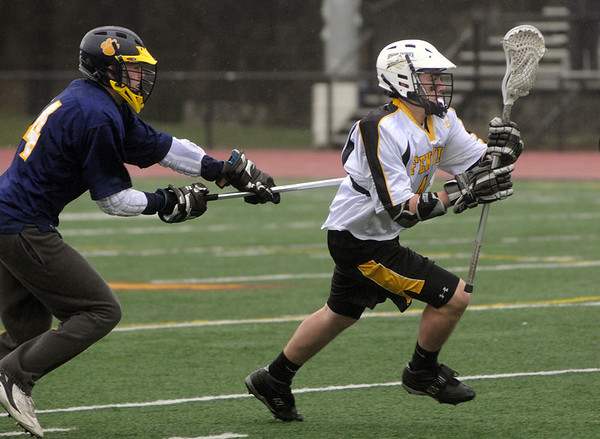 Peabody:<br /> Bishop Fenwick's Joe Shea carries the ball toward the net during the Arlington Catholic at Bishop Fenwick boys lacrosse game.<br /> Photo by Ken Yuszkus/Salem News, Wednesday, April 13, 2011.