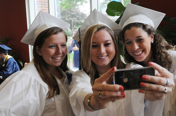 Wenham:<br /> From left, Kellie Kerrigan, Jillian Morong, and Victoria Tansey have their photo taken prior to the procession of the Hamilton-Wenham Regional High School graduation held at Gordon College.<br /> Photo by Ken Yuszkus/Salem News, Sunday, June 3, 2012.