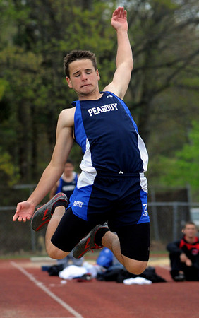 Peabody:<br /> Peabody's Chris Therrien flies through the air during one of his attempts at the long jump at the Salem at Peabody High co-ed outdoor track meet.<br /> Photo by Ken Yuszkus/Salem News, Tuesday, May 10, 2011.
