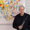 Manchester:<br /> Stephen Bates, who played clarinet with the Kennedy Center Opera Orchestra for three decades, will debut a new composition during the upcoming Music at Eden's Edge concerts. He is standing near a piece of art he created named, Piece For Solo Clarinet by Igor Stravinsky, while at his home.<br /> Photo by Ken Yuszkus/Salem News, Monday, June 20, 2011.