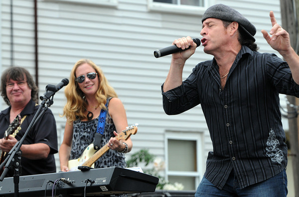 Peabody:<br /> From left, Kook Lawry on lead guitar, MaryBeth Maes on guitar and her husband Brian Maes on keyboard and vocals of the Brian Maes Band perform on one of the stages at the Peabody International Festival.<br /> Photo by Ken Yuszkus/The Salem News, Sunday, September 9, 2012.