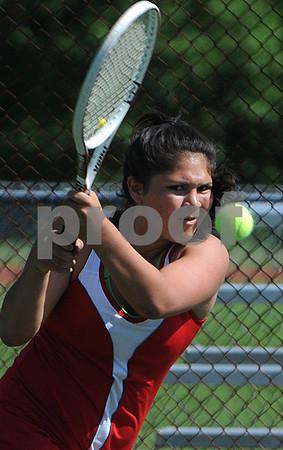 Topsfield:<br /> Masconomet's Mia Farnham keeps an eye on her return ball. Masconomet played Lincoln-Sudbury in Division 1 North playoff quarterfinals in girls tennis.<br /> Photo by Ken Yuszkus/Salem News,  Tuesday, June 2, 2009.