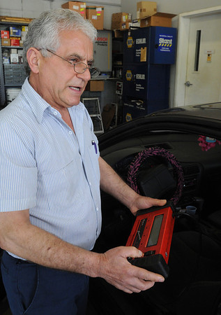 Danvers:<br /> John Sambatakos, owner of John's Auto Service, speaks about about Right to Repair legislation. He is holding his scanner which reads codes at his service station.<br /> Photo by Ken Yuszkus/Salem News, Wednesday, May 25, 2011.