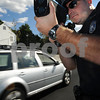 Salem: <br /> Kristian Hanson, Salem patrolman, uses a handheld laser speed gun on the newly opened 107 bypass.<br /> Photo by Ken Yuszkus/Salem News, Tuesday September 10, 2008.
