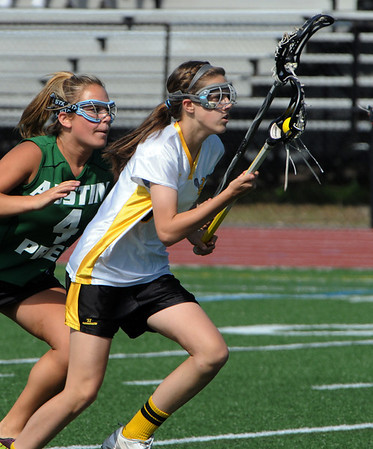 Peabody:<br /> Bishop Fenwick's Grace Celona runs toward the net followed by an Austin Prep player durintg the Austin Prep at Bishop Fenwick girls lacrosse Division 2 North first round state tournament game<br /> Photo by Ken Yuszkus/Salem News, Tuesday, May 31, 2011.