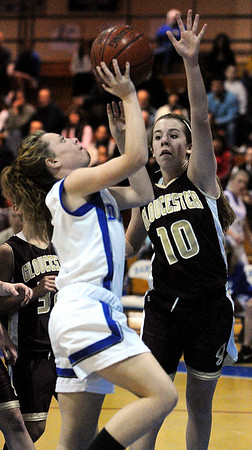 Danvers:<br /> Danvers' Becky Landers, left, is covered by Gloucester's Sophia Black as Becky tries to shoot during the Gloucester High School at Danvers High School girls basketball game.<br /> Photo by Ken Yuszkus/Salem News, Tuesday, January 4, 2011.