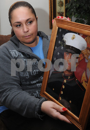 Peabody:<br /> Tabatha Mello holds a photo of her son, Damien, at her home. She is one of the first to graduate from the Teen Parent Program, which turned 20 last year, and provides parent skills classes and daycare so that students can finish their high school education. It accepts students from different communities.<br /> Photo by Ken Yuszkus/Salem News, Monday December 1, 2008.