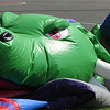 Hamilton:<br /> Mike Nolan removes the ground stakes holding Drekko the Dragon, an inflatable obstacle course, at the conclusion of the Hamilton-Wenham 4th of July activities on Patton Park.<br /> Photo by Ken Yuszkus/Salem News, Monday, July 4, 2011.