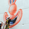 Salem:<br /> Pop artist Kenny Scharf is painting a mural on a portion of the Museum Place Mall garage in Salem.<br /> Photo by Ken Yuszkus/Salem News, Monday, May 14, 2012.