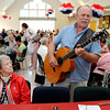 Danvers:<br /> Shirley Charnock, left, has a front row seat listening to Paul Wayne sing and play guitar at the Danvers Family Festival Senior Citizen Lunch held at the Danvers Senior Center.<br /> Photo by Ken Yuszkus/Salem News, Tuesday, June 26, 2012.