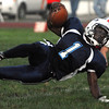 Peabody:<br /> Peabody's Nat Gaye slips to the ground while out running Salem during the Salem at Peabody football game at Coley Lee Field Friday night.<br /> Photo by Ken Yuszkus/Salem News, Friday, September 9, 2011.
