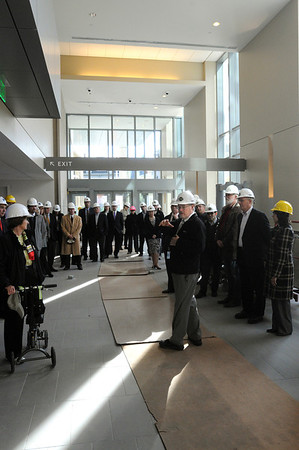 Salem:<br /> Richard L'heureux, center, manager of program and design for the trial court state system, speaks in the lobby as he leads a tour of the new state courthouse for members of the Salem Partnership.<br /> Photo by Ken Yuszkus/Salem News, Tuesday, November 31, 2011.