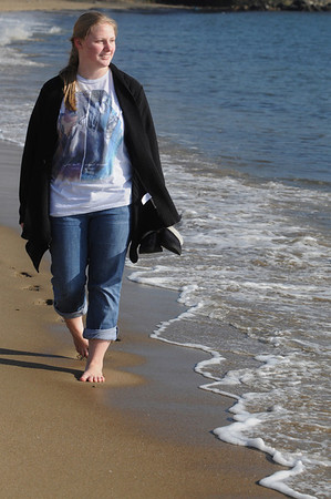 Beverly:<br /> Jessica Banta, of Beverly, walks barefoot in the sand along Dane Street Beach, enjoying the unseasonable warm weather.<br /> Photo by Ken Yuszkus/Salem News, Tuesday, January 24, 2012.