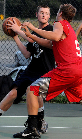 Danvers:<br /> Peabody's Jon Byrne gets ready to pass the ball at the Peabody vs Melrose North shore summer basketball league game.<br /> Photo by Ken Yuszkus/Salem News, Tuesday August 3, 2010.