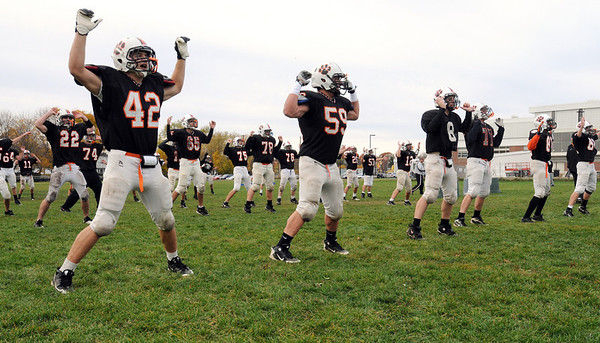 Beverly:<br /> The Beverly High School football players exercise at the start of practice Wednesday afternoon on the field at the school.<br /> Photo by Ken Yuszkus/Salem News,  Wednesday,  November 10, 2010.