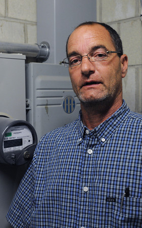 Beverly:<br /> Beverly wire inspector Edward Comeau recently won a settlement against the city of Beverly for $245,000 for illegally firing him nine years ago. Comeau was rehired by the city in June as a wire inspector. <br /> Photo by Ken Yuszkus/Salem News, Thursday, July 19,  2012.