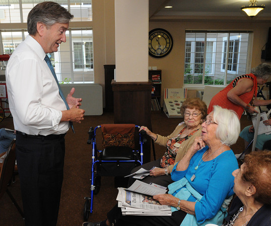 Danvers:<br /> From left, Congressman John Tierney speaks with residents, Aggie Mazzola, Betty Gurley, and Mary DePino just before his speech at Colonial Gardens Retiement Community.<br /> Photo by Ken Yuszkus/The Salem News, Thursday, August 16, 2012.