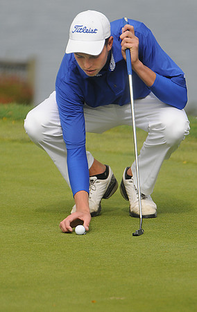 Salem:<br /> George Merry, of Danvers, lines up his shot at the 6th hole during the Northeastern Conference Golf Open at Kernwood Country Club. <br /> Photo by Ken Yuszkus/Salem News, Tuesday, October 18, 2011.
