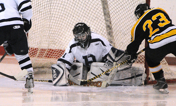 Peabody:<br /> Peabody's goalie Derek Savage stops the shot from Bishop Fenwick's Joe Shea during the Bishop Fenwick vs Peabody 24th annual Carlin Cup hockey game at the McVann-O'Keefe Rink in Peabody.<br /> Photo by Ken Yuszkus/Salem News, Monday, February 21, 2011.