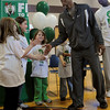 Salem:<br /> Rajon Rondo, Celtics point guard, greets students, from left, Vanessa McKinnin, Lily Brown, Grace Burns, and Dylan Picard at the start of the program promoting a healthy and active lifestyle at the Bates Elementary School. The students were responsible for the visit to the school. Brandon Bass, Celtics forward, Bryan Doo, Celtics strength and conditioning coach, and Lucky, the Celtics mascot, were also there.<br /> Photo by Ken Yuszkus/Salem News, Thursday,  March 8, 2012.
