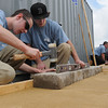 Middleton:<br /> Joey Cass, left, and Collin Bennett, both of Danvers and from the North Shore Technical High School, build a wall and patio area during the Trowel Trades Competition at the school. <br /> Photo by Ken Yuszkus/Salem News, Wednesday, May 23, 2012.