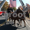 Beverly:<br /> The horse drawn hearse carring the casket of    Stephen R. Fortunato, passed under a large flag hung between two fire ladder trucks in front of St. Mary's Cemetery as it entered the cemetery. Stephen R. Fortunato, was killed in Afghanistan by a roadside bomb.<br /> Photo by Ken Yuszkus/Salem News, Friday, October 24, 2008.