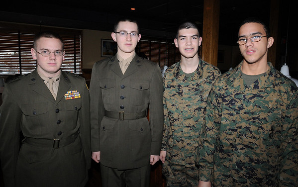 Peabody:<br /> From left, Matt Latter, Michael Carnevale, Sidney MacPhail, and Luis Gonzales, all of Beverly High School, gather at a luncheon at Outback Steakhouse to drum up support for Operation Homefront, a troop-support organization.<br /> Photo by Ken Yuszkus/Salem News, Wednesday, March 3, 2010.