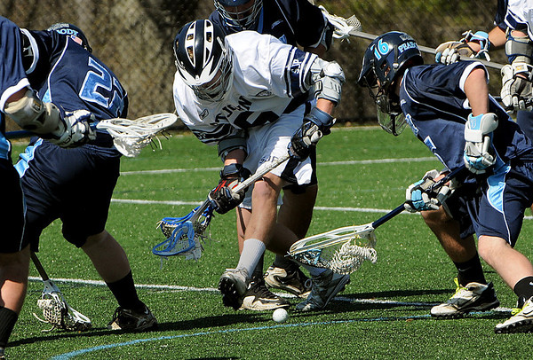 Danvers:<br /> Matt Scalise, center, of St. John's Prep, goes for the ball as well as Peabody's #16 ( whose name is not on the roster ) during the Peabody at St. John's Prep boys lacrosse game.<br /> Photo by Ken Yuszkus/Salem News, Saturday, April 3, 2010.