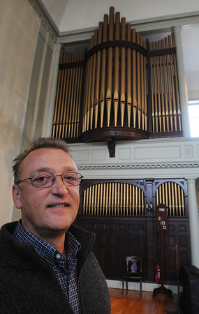 Salem:<br /> Michael Mazurkiewicz, organist at First Universalist Society of Salem, stands near the organ pipes at the church. First Universalist Society of Salem is having a fundraiser for its organ, which was originally built in 1888.<br /> Photo by Ken Yuszkus/Salem News, Friday,  April 8, 2010.